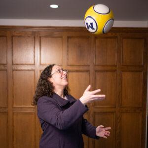 Helene Fligiel tossing a ball in the air