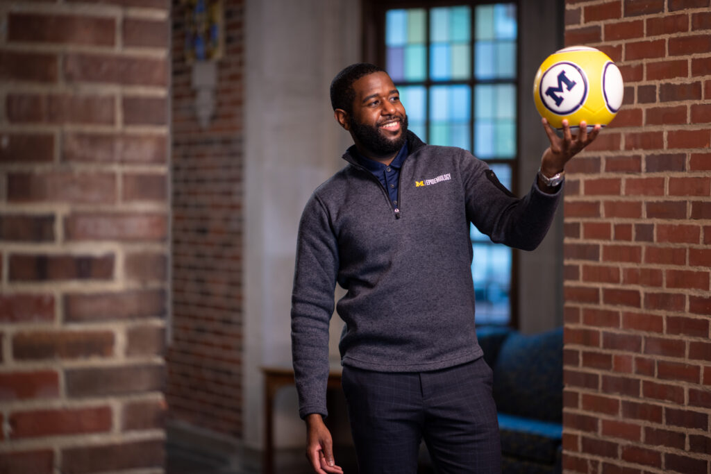 Marcus McKay holding a soccer ball.