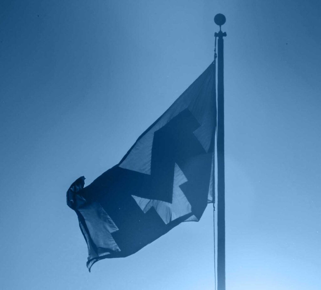 A flag with the Block M. Image credit: Austin Thomason, Michigan Photography