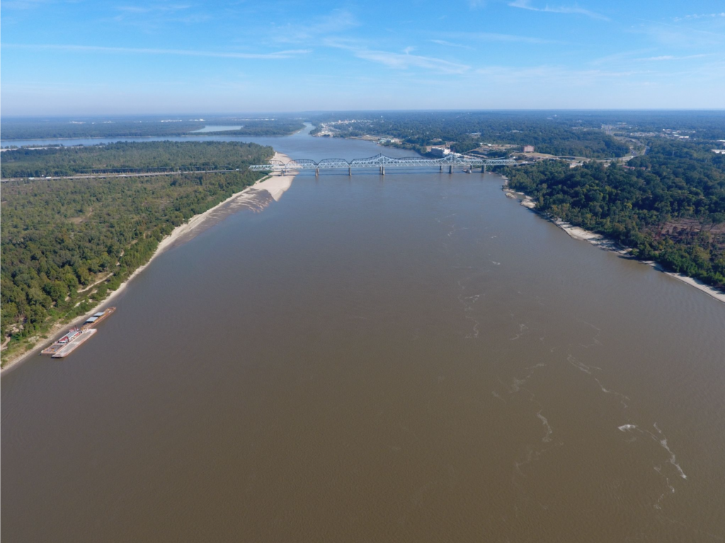 The Mississippi River near Vicksburg, looking Northeast at the Interstate 20 bridge, the confluence of the Yazoo River is in the foreground. The photo was taken by a drone flown by Jim Alvis and Mike Manning of the U.S. Geological Survey in the summer of 2016. Image credit: USGS