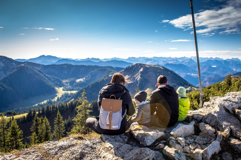 Family looking at mountains. Image credit: Pixabay