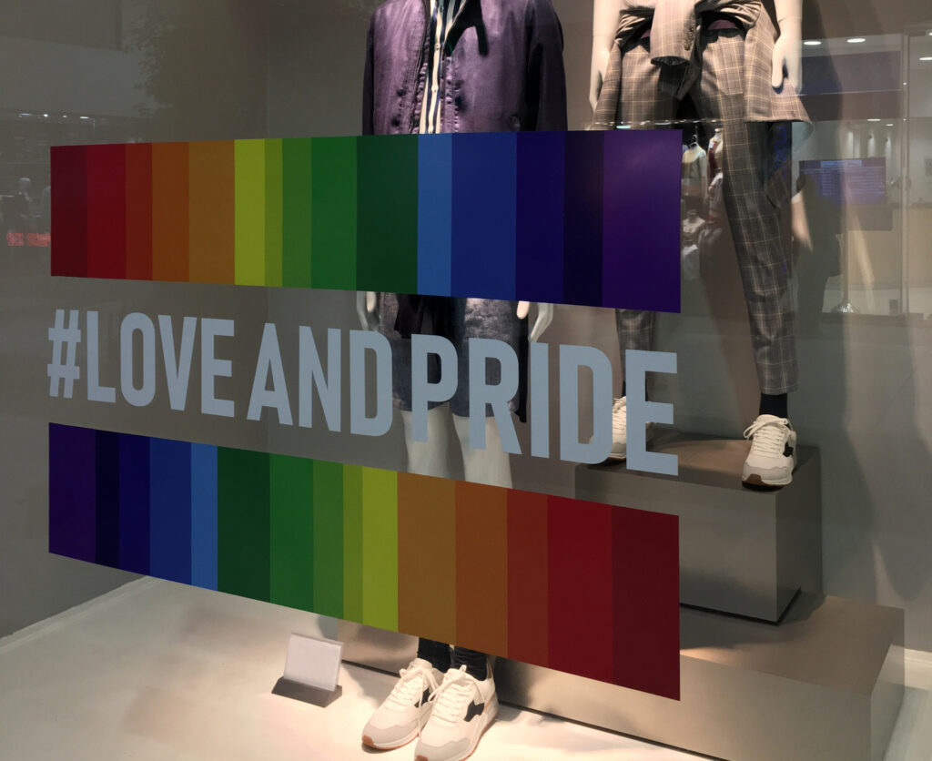 Buenos Aires, Argentina - November 8, 2018: Clothing store window with rainbow flag design over the glass as part of the celebration of the gay pride week in the city this month.