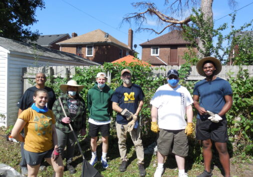 """Alley cleanup in the west McNichols area. Pictured (left to right): Amina Mikula, UM-Dearborn student, Robert Turner, resident, Anne Peeples, resident, Solomon Draus, UD-Jesuit student, Charles """"Chuck"""" Rivers, resident and president of the Neighborhood Association, Peyton Lynch, UM-Dearborn student, and Jacques Jones, UM-Dearborn student."""