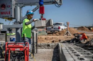 Barton Malow already uses simple robots on some job sites, such as the MULE, which helps workers place retaining wall block. The firm is a collaborator on a $2M, U-M led project that aims to enable robots to learn from and cooperate with human construction workers. Image credit: Construction Robotics