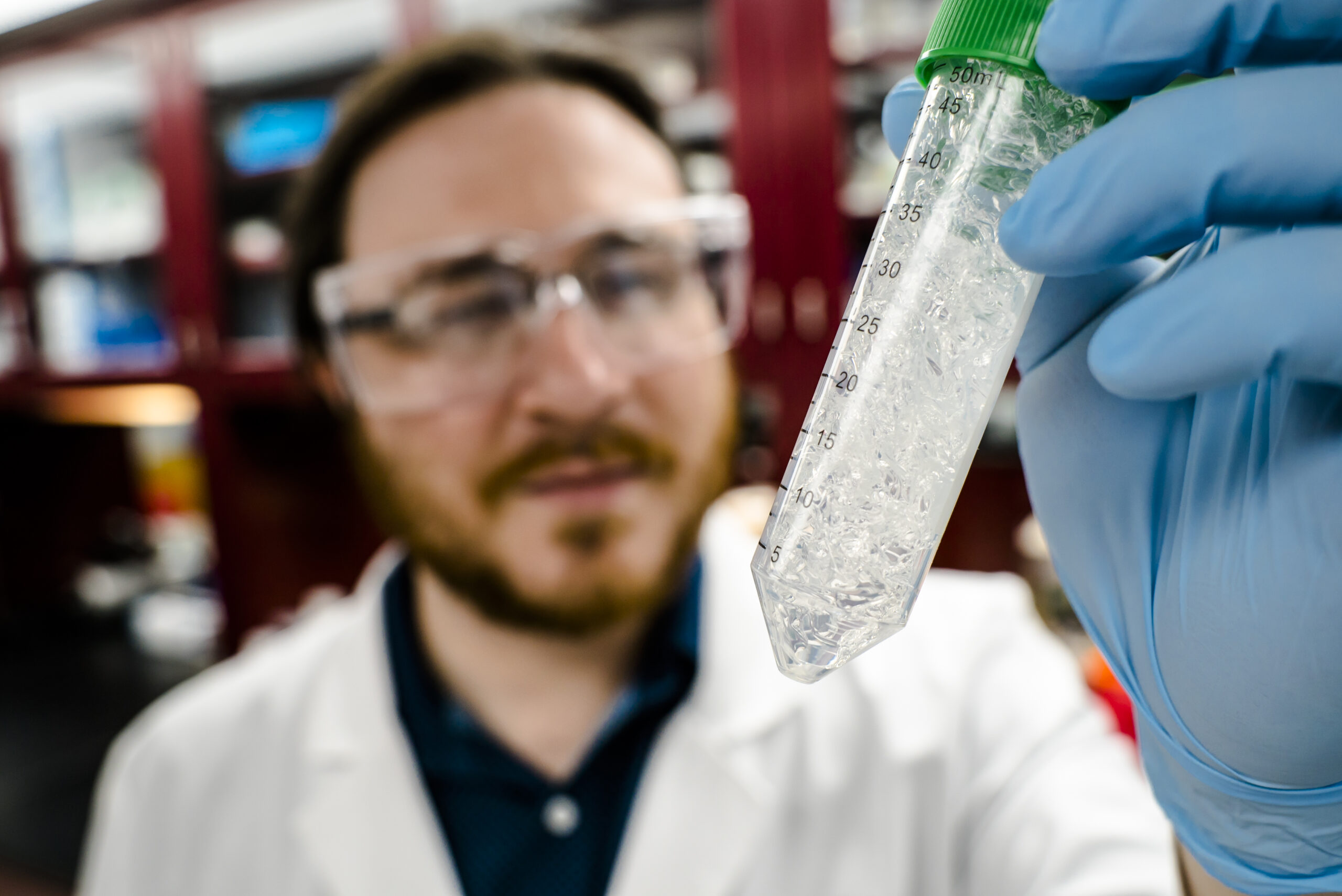 Jeremy Minty, a 2013 Ph.D. graduate of Michigan Engineering and co-founder of Ecovia Renewables, holds up a sample of the company's AzuraGel product in 2018. Minty participated in NSF's I-Corps program. Ecovia is developing a compostable biopolymer cosmetics. One of its uses could be in compostable diapers. Photo: Evan Dougherty/Michigan Engineering Communications & Marketing