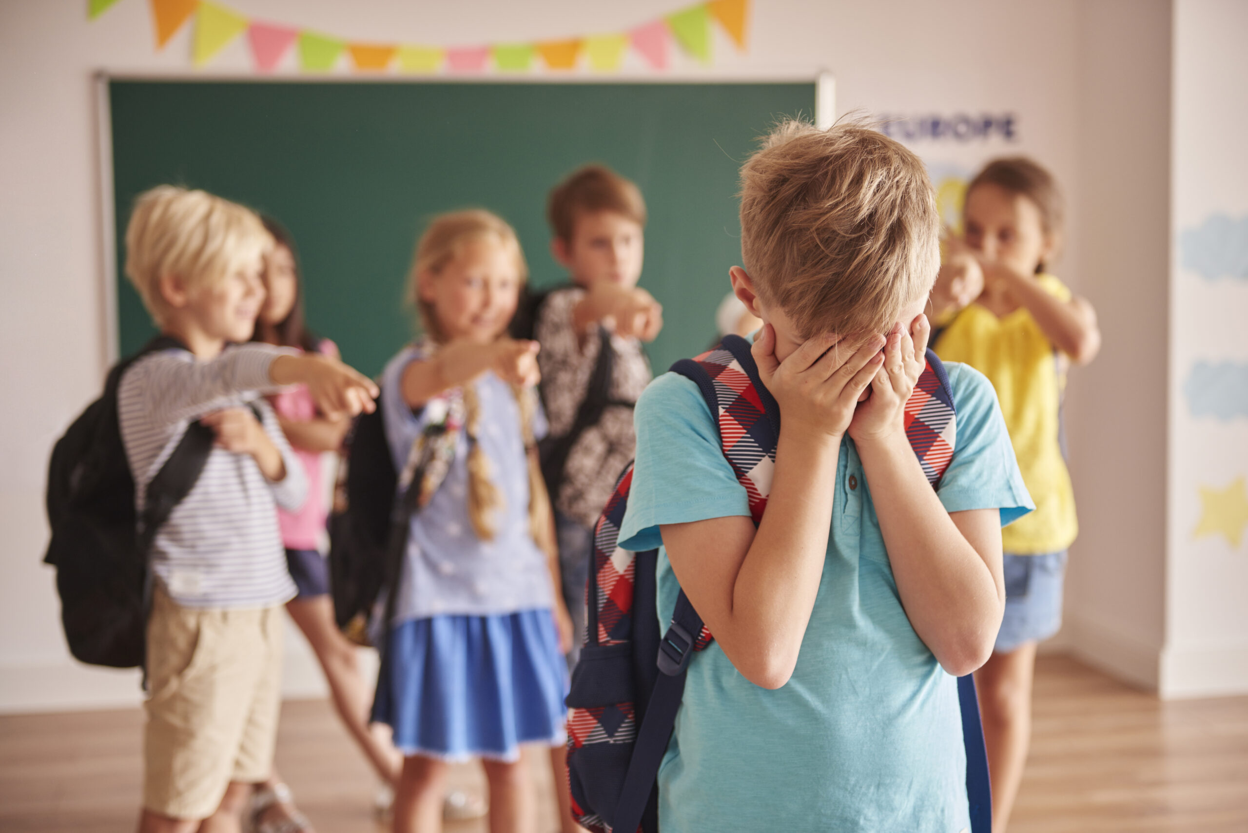 A child being bullied at school. Image credit: iStock