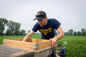 University of Michigan archeologist Brendan Nash screens excavated soil for manufacturing debris and Clovis tools on the Belson Clovis Site in St. Joseph County. Image credit: Daryl Marshke/Michigan Photography