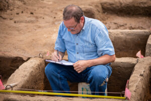 Independent researcher Thomas Talbot records his findings on the Belson Clovis Site in St. Joseph County. Image credit: Daryl Marshke/Michigan Photography
