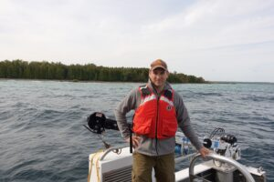 U-M microbiologist and oceanographer Gregory Dick aboard R/V Storm near Lake Huron's Middle Island Sinkhole. The Storm is a 50-foot NOAA research vessel. Photo credit: Jim Erickson, University of Michigan News.