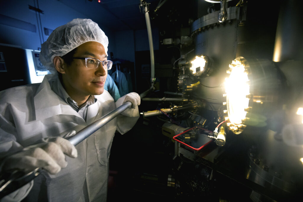 Zetian Mi, Professor of Electrical Engineering and Computer Science, produces a sample in the molecular beam epitaxy machine. Image credit: Joseph Xu, Michigan Engineering