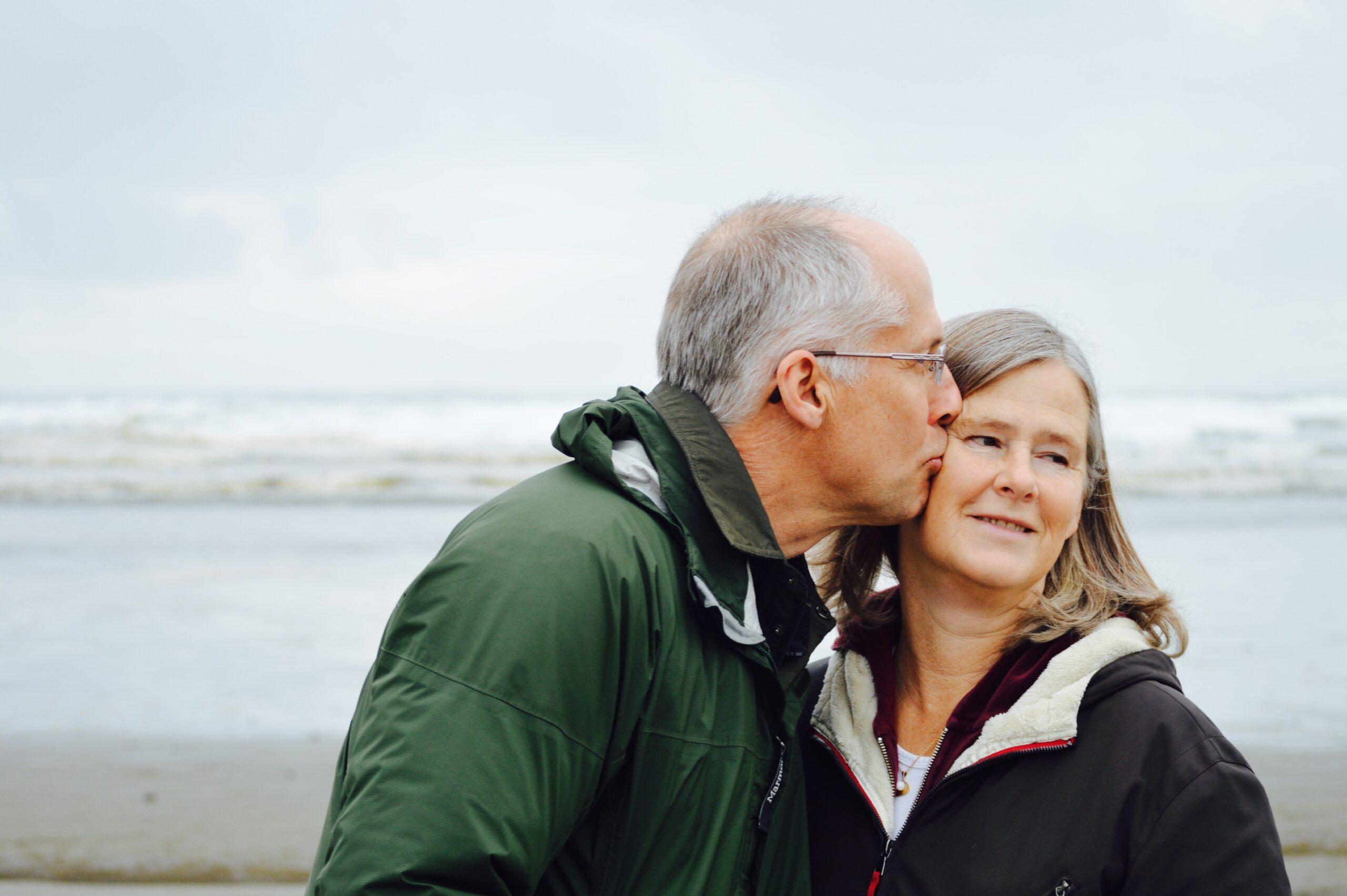 An older smiling couple. Image credit: Esther Ann, Unsplash