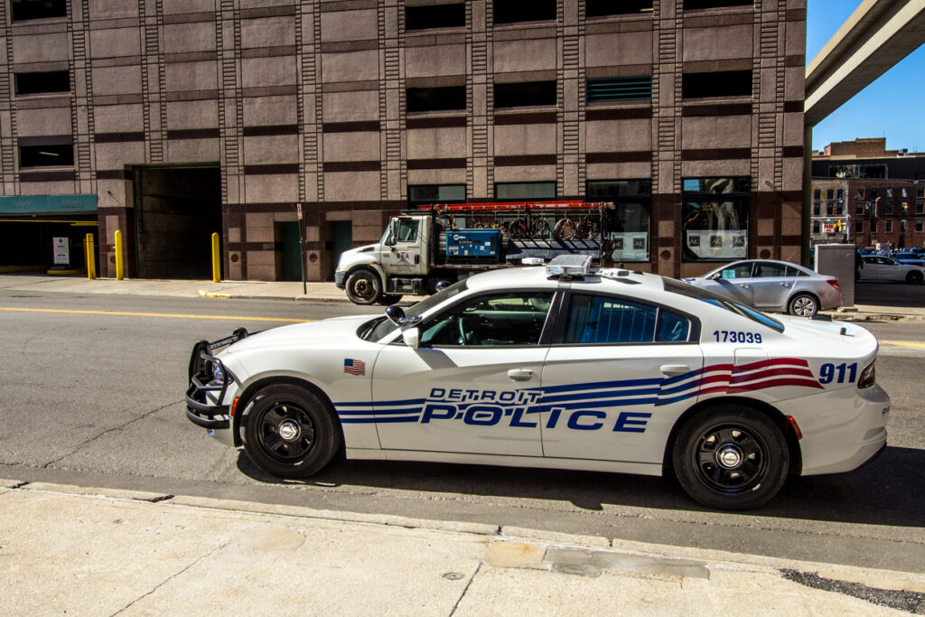 Detroit City Police Department car parked on the city street in downtown Detroit Michigan. Image credit: iStock