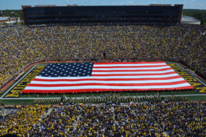 One of many patriotic tributes the Michigan Marching Band has performed over the years, their halftime show on Sept. 7, 2019 during the game against Army Black Knights unveiled a massive American Flag and a full lineup of patriotic music. Image credit: Robert Brown