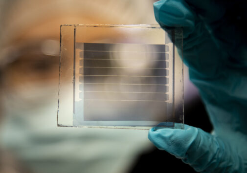Xinjing Huang, a doctoral student in Forrest's lab, holds a 20% transparency, 30-year solar cell module that she built.