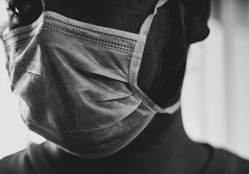 A Black man wearing a mask. Image credit: Tai's Captures, Unsplash.com