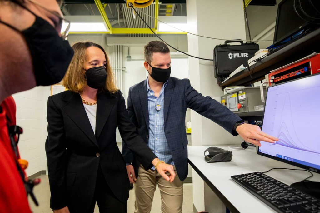 Christopher Meert (left), a graduate student in nuclear engineering and radiological sciences (NERS); Sara Pozzi (middle), a professor of NERS; and Shaun Clarke (right), an associate research scientist in NERS, develop algorithms that sift through the noisy data gathered by detectors. With smaller and more robust neutron sources now feasible for scanning cargo at ports and border crossings, the team's algorithms may help detect the smuggling of materials that could be made into nuclear weapons. Image credit: Robert Coelius, Michigan Engineering