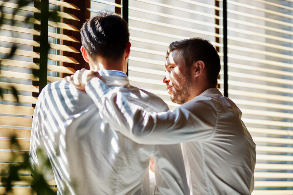 Two business men chatting. Image credit: iStock